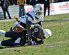 Navy QB Keenan Reynolds loses the ball as he is tackled by #38T.T Barber.