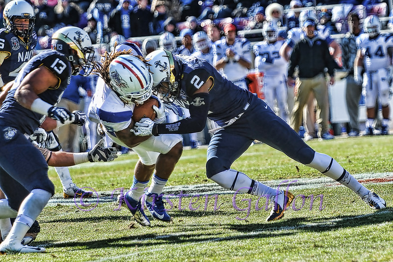 Safety Parrish Gaines puts the stop on WR Kyle Griswould.