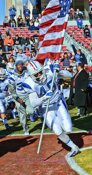 #49 Middle Tennessee State defensive end Steven Rhodes leads his team onto the field at the start of the game.