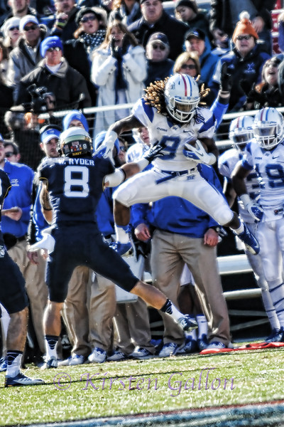 #9 Middle Tennessee State WR Kyle Griswould gets some air as he makes pass reception.