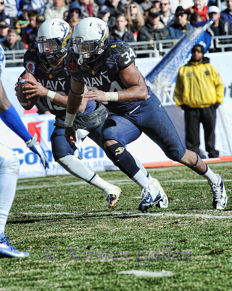 Armed Forces Bowl 2014<br /> QB Keenan Reynolds #19 and FB Noah Copeland are stride for stride as they try to gain some ground.