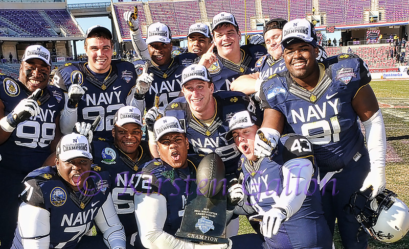 Navy team members celebrate their win.