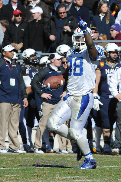 Armed Forces Bowl 2014<br /> Middle Tennessee linebacker T.T. Barber signals to the crowd after making another fumble recovery.