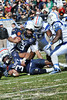 Middle Tennessee State players T.T. Barber #38 and #90 Jimmy Staten close in on QB Tago Smith to make the stop.