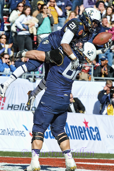 Sanders gets a lift from his teammate, OT Bradyn Heap, after his touchdown.