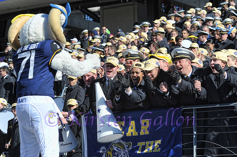 Bill the Goat leads the Navy fans in cheers to support the team.
