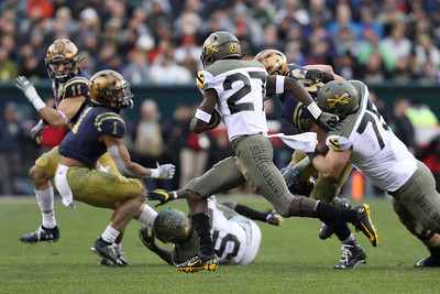 Army running back #27 Brandon Walters carries the ball with the help of a block from #75 Jack Sides.