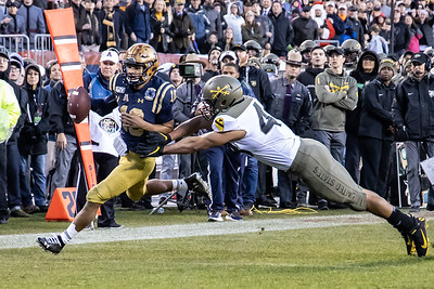 Army #43 Jeremiah Lowrey pushes Navy quarterback #10 Malcom Perry out of bounds short of the end zone.