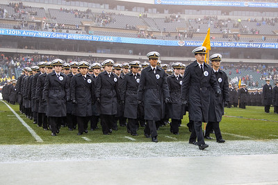 The Navy midshipmen march off the field.