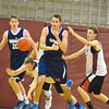 Poland's Piotr Karpacz passes the ball out of traffic to teammate Martins Bulans,of Latvia. Nashoba Valley Voice/Ed Niser