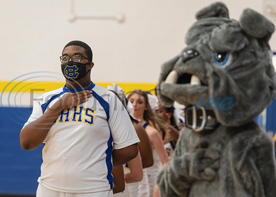 Chapel Hill High School cheerleader Jo-Covin Campbell wears a face mask as he stands for the National Anthem before the varsity volleyball game against the visiting Arp High School team at Chapel Hill High School in Tyler on Tuesday, Aug. 11, 2020. The school enforced a reduced 50 percent capacity in the gymnasium as well as blocking off every other row in the bleachers for seating and requiring face masks.