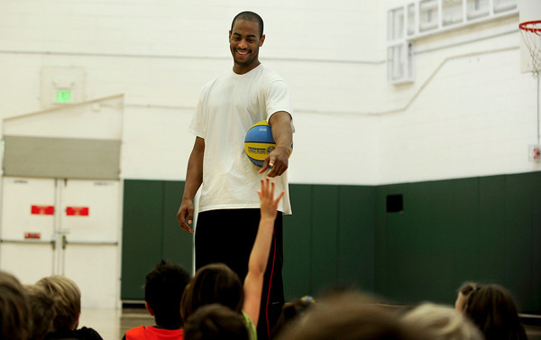 """Arron Afflalo, an NBA player of the Denver Nuggets, points to answer a question at South Boulder Rec Center. Afflalo came to visit a kids basketball camp Tuesday morning to sign autographs, play and talk with the kids. August 7, 2012. Rachel Woolf/ For the Daily Camera. For more photos, go to  <a href=""""http://www.dailycamera.com"""">http://www.dailycamera.com</a>."""