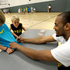 "Arron Afflalo, an NBA player of the Denver Nuggets, autographs from left, Caden Clark's, 7, of Boulder, shirt while Owen Reid, 7, of Louisville, watches at South Boulder Rec. Center. Afflalo came to visit a kids basketball camp Tuesday morning to sign autographs, play and talk with the kids. August 7, 2012. Rachel Woolf/ For the Daily Camera. For more photos, go to  <a href=""http://www.dailycamera.com"">http://www.dailycamera.com</a>."