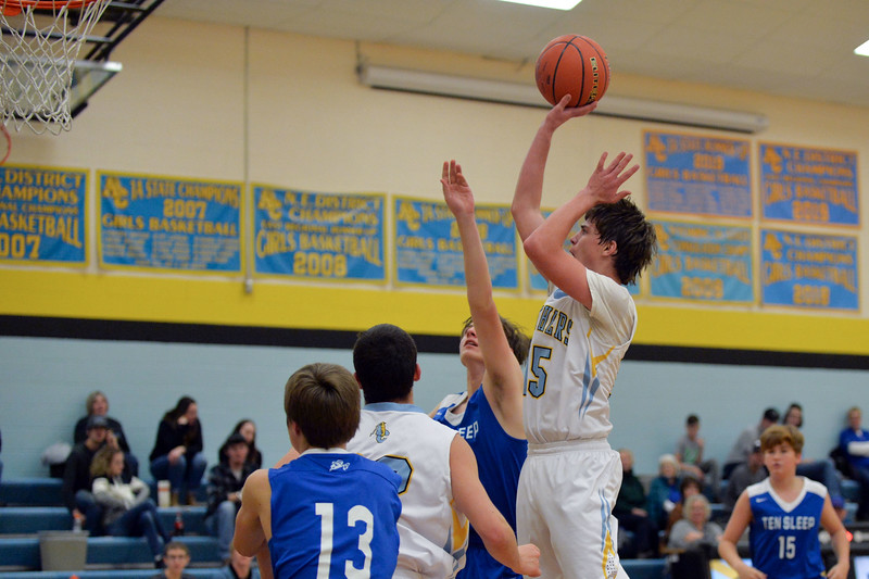 Joel Moline   The Sheridan Press<br /> Arvada-Clearmont's Torrey Veach (15) rises above the defense to score two points against Ten Sleep High School, Saturday, Jan. 4 2020.