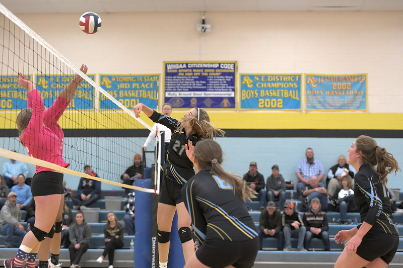 Matthew Gaston | The Sheridan Press<br>Arvada-Clearmont's McKenna Auzqui (21) spikes the ball after a long rally during the match with Hulett Saturday, Oct. 26, 2019.