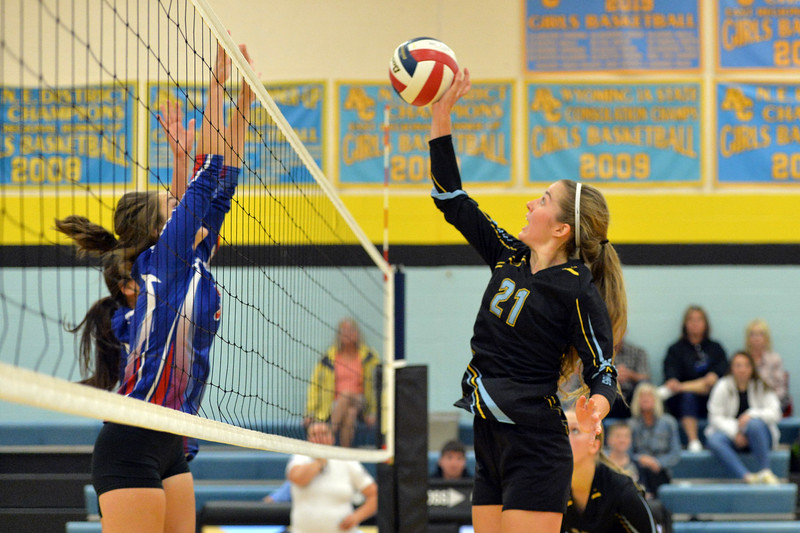 Joel Moline   The Sheridan Press<br /> Arvada-Clearmont's McKenna Auzqui spikes the ball against Kaycee Friday, Sept. 20, 2019.