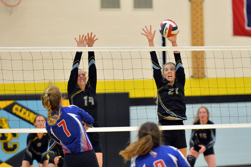 Joel Moline   The Sheridan Press<br /> Arvada-Clearmont's McKenna Auzqui (21) and Krista Malli (14) try to block a hit against Kaycee Friday, Sept. 20, 2019.