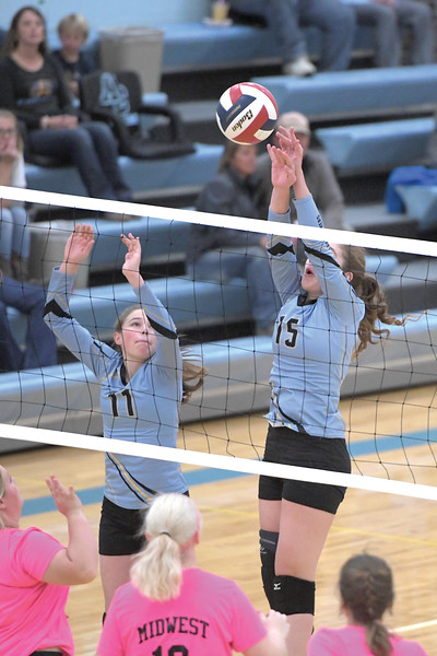 Matthew Gaston | The Sheridan Press<br>Arvada-Clearmont's Ashlynn Fennema (15) comes up with a big block against Midwest Friday, Oct. 18, 2019.
