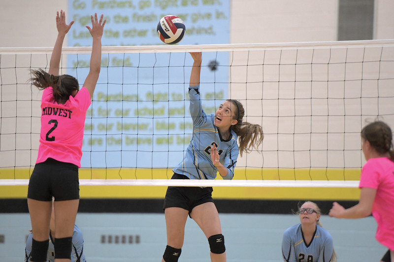 Matthew Gaston | The Sheridan Press<br>Arvada-Clearmont's McKenna Auzqui (21) makes the kill against Midwest Friday, Oct. 18, 2019.