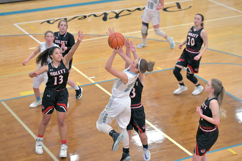 Matthew Gaston | The Sheridan Press<br>Arvada-Clearmont's Tavin Hampshire (25) makes the shot and draws the foul from Hulett's Jessee Driskill (23) Saturday, Jan. 25, 2020. The Lady Panthers won 48-23.