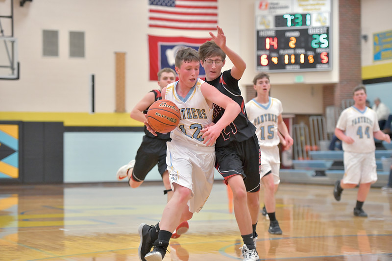 Matthew Gaston | The Sheridan Press<br>Arvada-Clearmont's Norris Graves (12) gets a step on Hulett's Hunter Kelly (21) Saturday, Jan. 25, 2020.