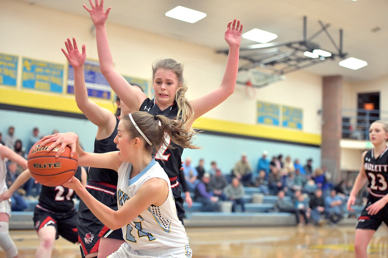Matthew Gaston | The Sheridan Press<br>Arvada-Clearmont's McKenna Auzqui (24) makes the bounce pass underneath to Ashlynn Fennema to score against Hulett Saturday, Jan. 25, 2020.