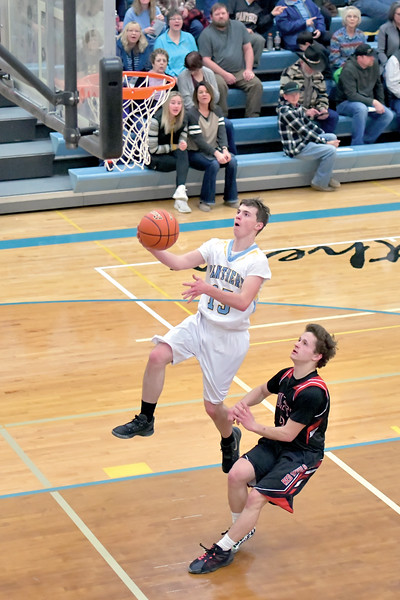 Matthew Gaston | The Sheridan Press<br>Arvada-Clearmont's Torrey Veach (15) scores on a break away against Hulett Saturday, Jan. 25, 2020.