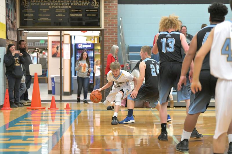 Matthew Gaston   The Sheridan Press<br>Arvada-Clearmont's Cameron Klatt (11) breaks down the baseline toward the basket during play against NSI Thursday, Dec. 19, 2019.