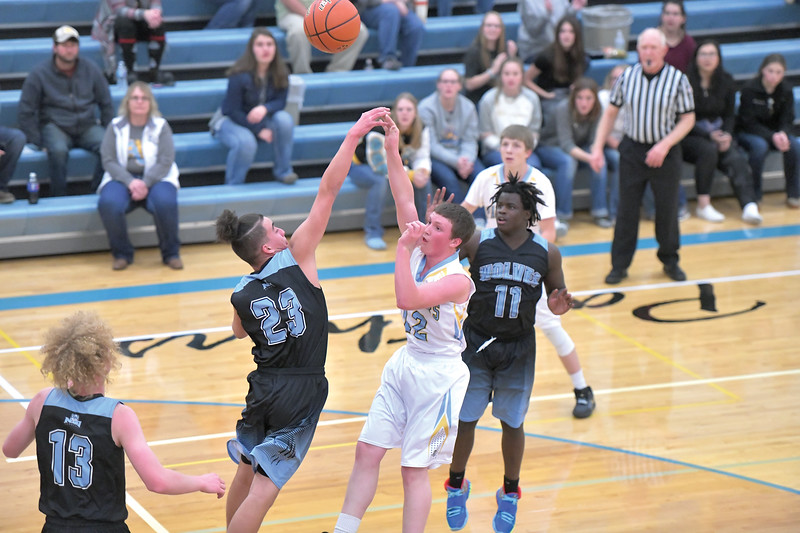 Matthew Gaston   The Sheridan Press<br> Arvada-Clearmont's Norris Graves (12) shoots over the NSI defender Thursday, Dec. 19, 2019.
