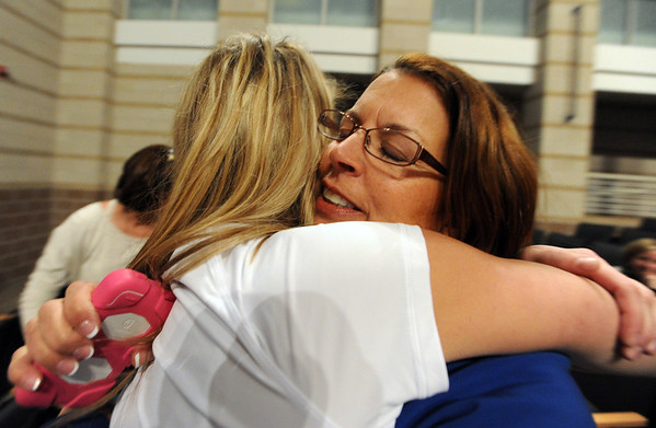 "Ashton Davis, left, gets a hug from her mother, Robin, at the signing ceremony at Monarch High on Wednesday.<br /> Ashton Davis of Monarch High School has signed with Air Force to play basketball next year.<br /> For a video of Davis, go to  <a href=""http://www.dailycamera.com"">http://www.dailycamera.com</a>.<br /> Cliff Grassmick / November 9, 2011"