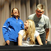 "Ashton Davis signs the letter to play for Air Force, as her parents, Robin and Walter, look on.<br /> Ashton Davis of Monarch High School has signed with Air Force to play basketball next year.<br /> For a video of Davis, go to  <a href=""http://www.dailycamera.com"">http://www.dailycamera.com</a>.<br /> Cliff Grassmick / November 9, 2011"