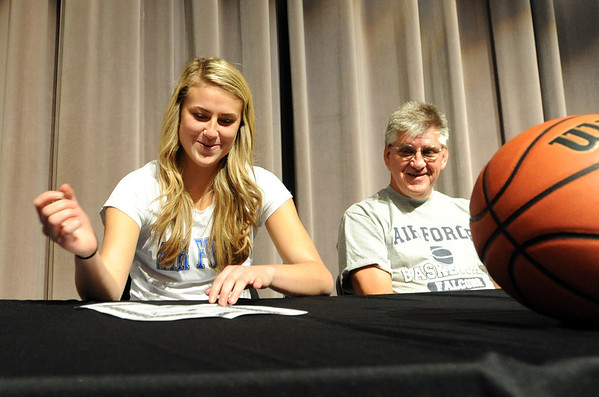 "Ashton Davis takes a big breath as she signs the letter to play for Air Force, her dad, Walter, looks  on.<br /> Ashton Davis of Monarch High School has signed with Air Force to play basketball next year.<br /> For a video and more photos of Davis, go to  <a href=""http://www.dailycamera.com"">http://www.dailycamera.com</a>.<br /> Cliff Grassmick / November 9, 2011"