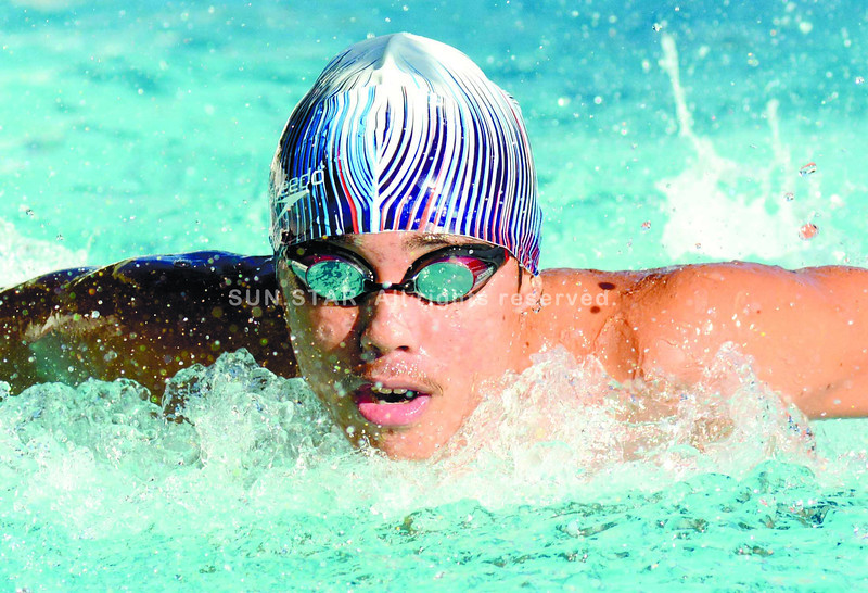 HEADLONG. Central Visayas swimmer Michael Ichiro Kong plunges for the 200-meter butterfly to win a bronze medal in the secondary boys in the 2013 Palaro games held in Dumaguete City. (Alex Badayos)