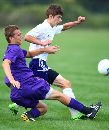 8-22-13   ---   Northwestern HS vs Guerin Catholic HS Boys Soccer. Final Score 4-3 Guerin. Guerin's Andrew Kaskie and NW Robert Olsen battle for the ball. Robert Scored NWs first 2 coals. third goal was by Blaine Brutus.<br /> KT photo | Tim Bath