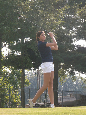 Teutopolis' Haley Giles watches her drive on the 12th hole at Cardinal Golf Course during the Lady Shoes' season-opening meet against Champaign St. Thomas More.