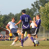Teutopolis' Kyle Blievernicht kicks the ball between two Taylorville defenders near the Tornadoes goal during the Wooden Shoes' season opener.