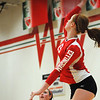Effingham's Chandler Ramey skies for a spike during the Meet the Hearts volleyball night during the varsity/junior varsity scrimmage.