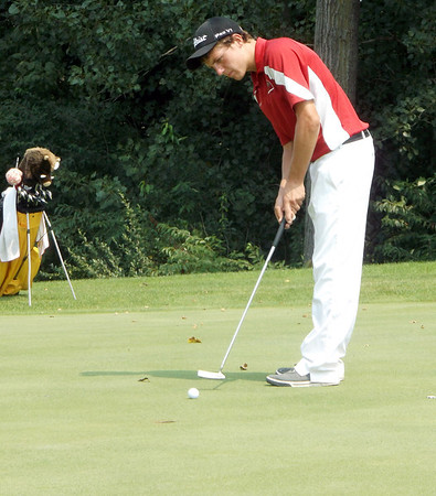 St. Anthony's Garrett Hixenbaugh follows through on his putt and watches it track toward the hole at the St. Anthony Invitational at Fox Prairie Golf Course in Windsor.