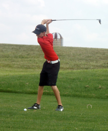 Effingham freshman Callaway Smith reaches the apex of his backswing and prepares to drive the ball on the first hole at the St. Anthony Invitational at Fox Prairie Golf Course in Windsor.