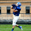 Newton's Jake Volk hauls in a pass from Tim Weber during Newton's media night scrimmage.