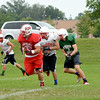 The Effingham Flaming Hearts work on their rushing attack during practice at Effingham High School, in preparation for the season starting on Aug. 29 at Breese Mater Dei.