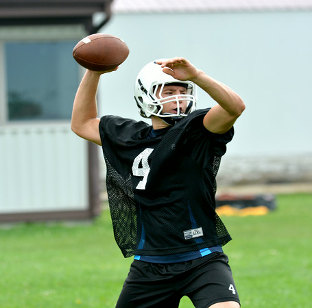 Cumberland quarterback Monte Wolke throws an out route during the Pirates' first practice of the 2014 season.