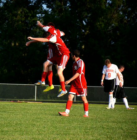 Effingham's Sean Zerrusen and Michael Carie celebrate after Zerrusen's goal during the second half of the Hearts' 7-0 victory over Altamont Tuesday at Altamont Grade School.