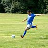 Newton's Trenton Gonzalez takes a free kick during one of Newton's first-ever soccer practices for the new program.