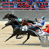 Bigolwezeweddwess (4, back) edges out Bands One Eye Love (2, front) during the Big 10 2-Year-Old filly trot in the first race of the day at the Effingham County Fair's harness racing.