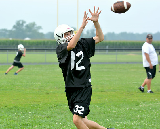 Cumberland's Gunner McMechan catches a pass at the Pirates' first practice of the season.