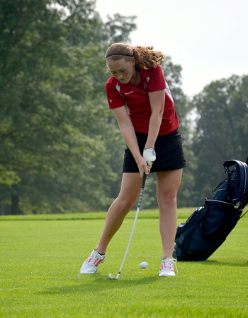 St. Anthony's Madison Bushue hits a shot from the fairway on the seventh hole at Charleston Country Club.