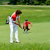 Effingham's Jackson Wendling looks on as St. Anthony's Garrett Hixenbaugh putts during the St. Anthony Invitational at Fox Prairie Golf Course in Windsor.