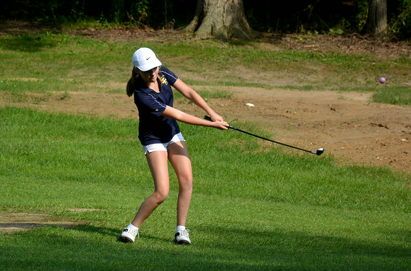 Teutopolis' Madison Magee hits an approach shot as her purple ball flies through the air during Teutopolis' season-opening match with Champign St. Thomas More at Cardinal Golf Course.