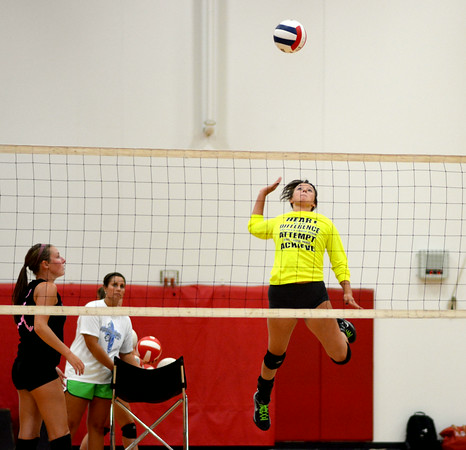 Effingham's Katie Roberts skies for a spike during volleyball practice at Effingham High School.